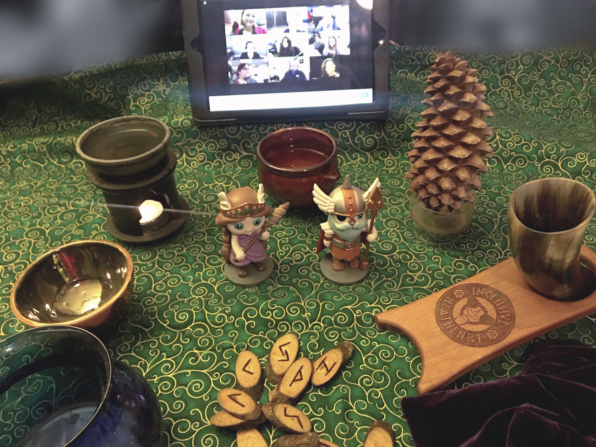 Desk top altar set up. iPad screen,representations of the gods; incense and offering; divination tools (runes, scrying bowl), and an offering bowl.